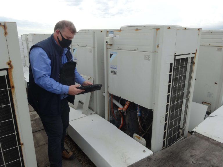 Engineers are checking the air cooled chiller, located on the roofs of the building.
